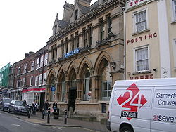 """Leighton Buzzard, High Street. The former """"Bassett's Bank"""" (now Barclays Bank) designed by the eminent Victorian architect Alfred Waterhouse."""
