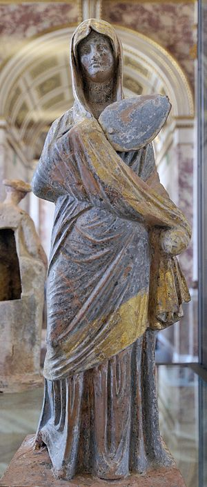"""Tanagra figurine - """"Lady in blue"""", molded and gilded terracotta figurine, Louvre, Paris"""