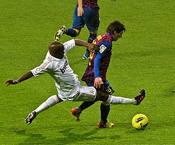 Real Madrid's Lassana Diarra tackling Barcelona's Lionel Messi during a 2011 Clásico.