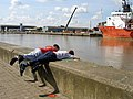Local boys fish for crabs from the quay - geograph.org.uk - 525331.jpg