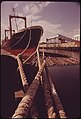 Logs Are Loaded Aboard Freighter at the Columbia River Mouth for Export to Japan 05-1973 (4272360708).jpg