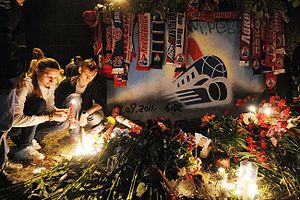 Lokomotiv Yaroslavl plane crash - People lighting candles at a makeshift memorial outside Arena 2000 in Yaroslavl.