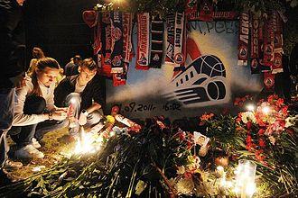 Lokomotiv Yaroslavl plane crash - People lighting candles at a makeshift memorial outside Arena 2000 in Yaroslavl.