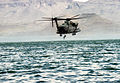 MH-53J Pave Low III helicopter from the 1550th Combat Crew Training Wing hovers over Elephant Butte Lake as a member of a Navy Sea-Air-Land (SEAL) team climbs aboard DF-ST-91-11163.jpg