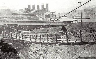 Kennett, California - Foot bridge across the Sacramento River to the Mammoth Smelter, Kennett ca. 1910.