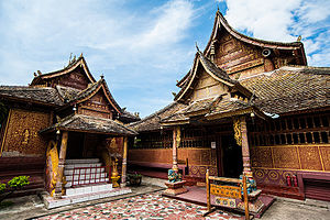 Xishuangbanna Dai Autonomous Prefecture - Dai Ethnic Garden, 30 kilometers away from Jinghong city, is a popular ethnic theme park with natural Dai village and Buddhist temple