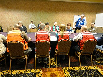 Emergency service - EPA staff coordinate with local agencies in 2014 environmental disaster simulation