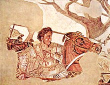 A young, clean-shaven man in heavy armour sits astride a brown horse. His breastplate bears the face of the Medusa. Although his companions wear metal helms, only his short curly dark hair separates him from a deadly blow. In his right hand he grasps the shaft of a long spear. His determined face stares in sharp profile toward the right of the picture.
