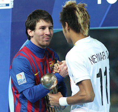 Messi accepting the Golden Ball award, alongside his future teammate Neymar after the 2011 FIFA Club World Cup Final Messi with Neymar Junior the Future of Brazil.jpg