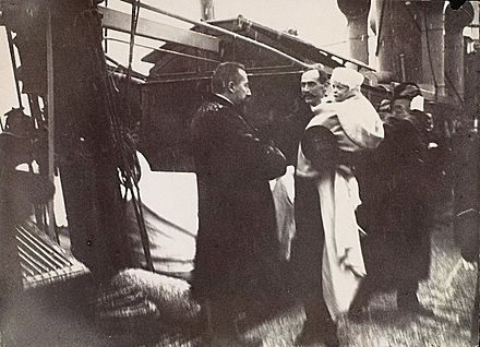 Michelsen greets King Haakon and prince Olav as they arrive in Norway for the first time in 1905 Michelsen Haakon 1905.jpg