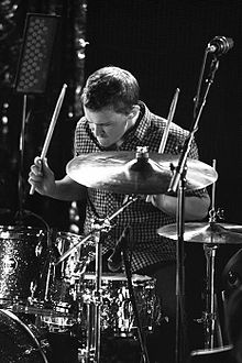 Mike Byrne—a Caucasian male 21 years old drummer in a black and white photo