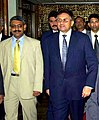Mohammad Mosaddak Alimet with President of Pakistan Pervez Musharraf at the Chin Moitree Sommelon Kendra in Dhaka.jpg