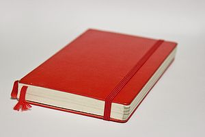 Moleskine notebook.