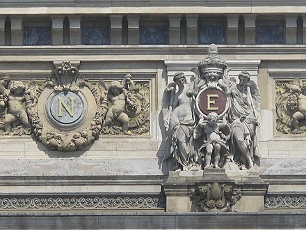 "Monogram of ""N"" for Napoleon III on the facade of the Opera Garnier in Paris. The ""E"" is for the empress Eugenie. Monogram Napoleon III NE.jpg"