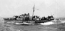 Motor Gun Boat moving left to right at sea