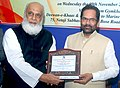 Mukhtar Abbas Naqvi being presented a memento by the Chairman, All India Haj Umrah Tour Organizers Association, Shri Ebrahim Hasham Kolsawala at the 'Haj Conference of PTOs', in Mumbai.jpg