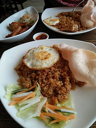 "Nasi goreng - Indonesian nasi goreng - ""fried rice with egg, krupuk (traditional cracker) and pickles."