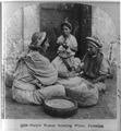 Native women grinding wheat, Palestine.tiff