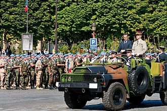 Head of state - Nicolas Sarkozy, President of France and General Jean-Louis Georgelin, Chief of the Defence Staff, reviewing troops during the 2008 Bastille Day military parade on the Champs-Élysées in Paris