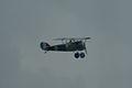 Nieuport 27 FlyBy 02 ThruDirtyWindow Dawn Patrol NMUSAF 26Sept09 (14619970043).jpg