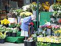 Old lady buying flowers.JPG