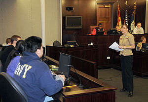Opening statement - A legalman making an opening statement for the prosecution to a jury during a mock trial.