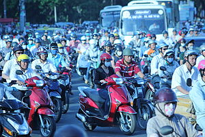 Human overpopulation - Thousands of scooters make their way through Ho Chi Minh City, Vietnam.