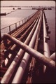 PIPELINES FROM DOCK OF NORTHEAST PETROLEUM TANKER TERMINAL ON MT. HOPE BAY. TO GUARD AGAINST OIL SPILLS, EACH SHIP... - NARA - 547501.tif