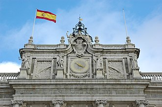 Flag of Spain - The flag of Spain on the south façade of the Royal Palace of Madrid