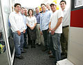 Part of the Urchin Software Corp. team is greeted by Eric Schmidt, Google CEO.jpg