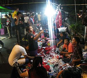 Bargaining - People bargaining in a traditional Indonesian pasar malam (night market) in Rawasari, Central Jakarta.