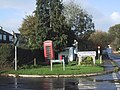 Phone box and bus shelter in Whitestone village - geograph.org.uk - 1567930.jpg