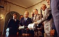 Photograph of President Gerald Ford, Soviet Ambassador Anatoly Dobrynin, and the Apollo-Soyuz Crews Looking at a Model of the Apollo-Soyuz Spacecrafts in the Cabinet Room - NARA - 7347187.jpg