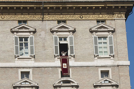 Pope Benedict XVI reciting the weekly Angelus prayer while overlooking Saint Peter's Square, Vatican City Pope Benedict XVI Delivers Angelus.jpg