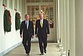 President Bill Clinton and President-Elect George W. Bush walk along the White House colonnade to the Oval Office.jpg