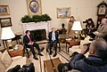 President George W. Bush talks with members of the media during his meeting with Panama's President Martin Torrijos in the Oval Office.jpg