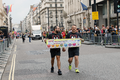 Pride in London 2016 - Men with an Orlando-themed banner ahead of the main parade.png