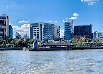 Queensland University of Technology's Gardens Point campus with ferry wharf in the foreground QUT Gardens Point ferry wharf seen from the river, June 2019.jpg