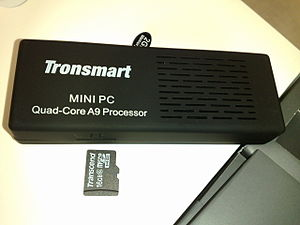 "Rockchip - Tronsmart MK908, a Rockchip-based quad-core Android ""mini PC"", with a microSD card next to it for a size comparison."