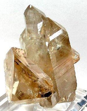 Champagne (color) - Champagne-colored topaz crystals on quartz