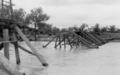 Queensland State Archives 6406 Flood Damage Rail Bridge Location Unknown c 1955.png