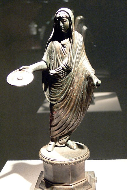 A Roman priest, his head ritually covered with a fold of his toga, extends a patera in a gesture of libation (2nd-3rd century) RMW - Opfernder Togatus.jpg