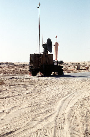 Tracking system - An M998 High-Mobility Multipurpose Wheeled Vehicle (HMMWV) carrying a radar and tracking system shelter sits parked at an airfield during Operation Desert Shield. The shelter is used by the Marines of the 3rd Remotely Piloted Vehicle (RPV) Platoon to track their Pioneer RPVs during flight.