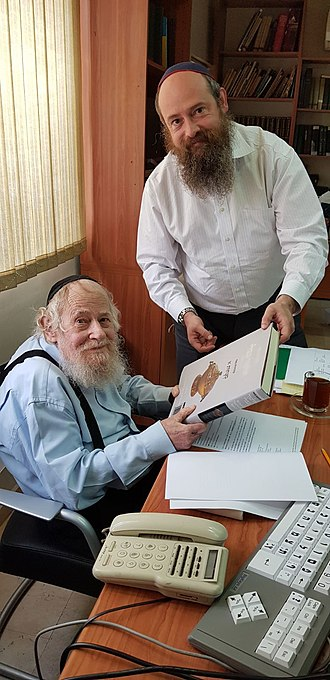 Adin Steinsaltz - Rabbi Meni Even-Israel and his father, Rabbi Adin Even-Israel Steinsaltz, inspect a newly printed volume of the Koren Noe Talmud series, an elegant and intuitive English-language edition of the Babylonian Talmud that is shaped by Rabbi Steinsaltz's acclaimed translation and commentary. (2018)