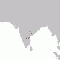 Specimen records in grey and current distribution in red.