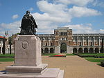 Rice University - Rice statue with Lovett Hall.JPG