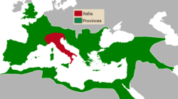 Roman Empire at its greatest extent c. 117 AD, with Italy in red and Provinces in green.