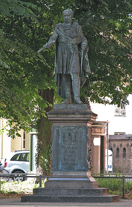 Blucher monument in front of the University of Rostock's main building, created by Johann Gottfried Schadow in collaboration with Johann Wolfgang von Goethe Rostock Blucher Denkmal.jpg
