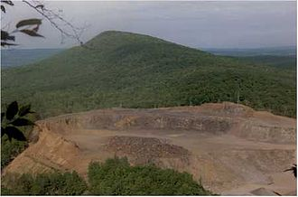 Metacomet-Monadnock Trail - Obliteration of Round Mountain by quarrying. 1989 photo; significantly more rock has been removed since then.
