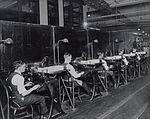 Row of Postal Clerks Processing Mail (2550229291).jpg